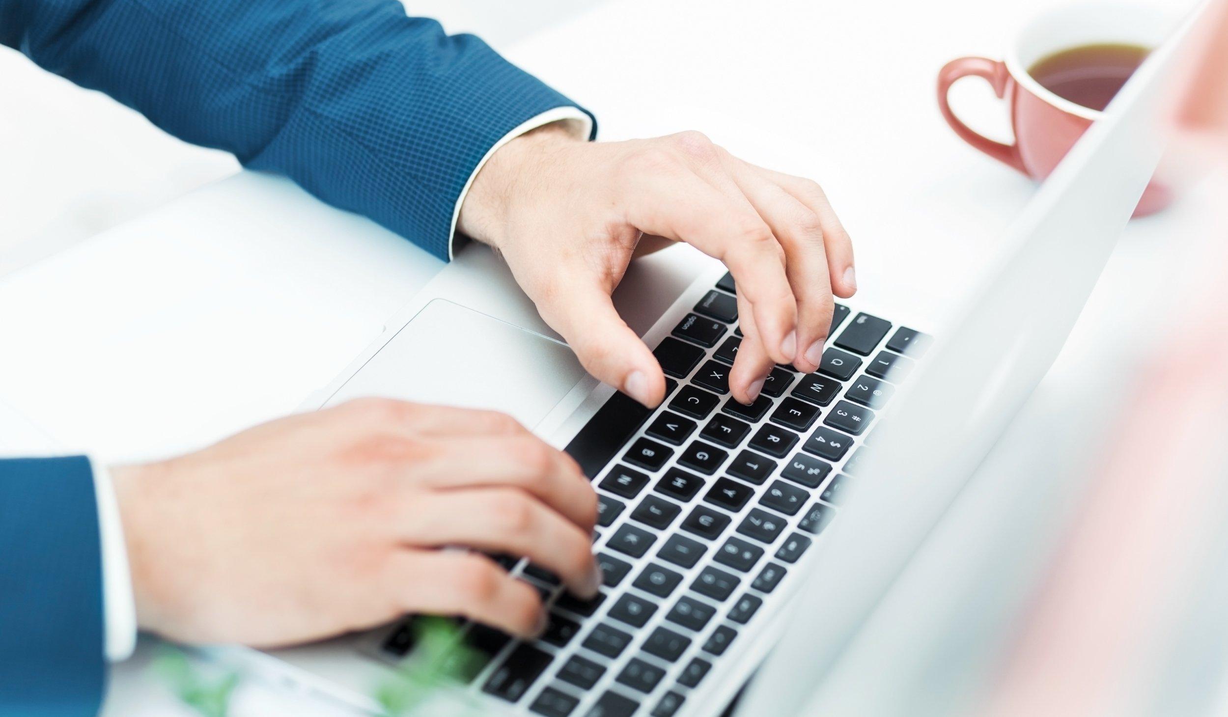 Businessman training to use Botkeeper Platform on a Laptop | Botkeeper