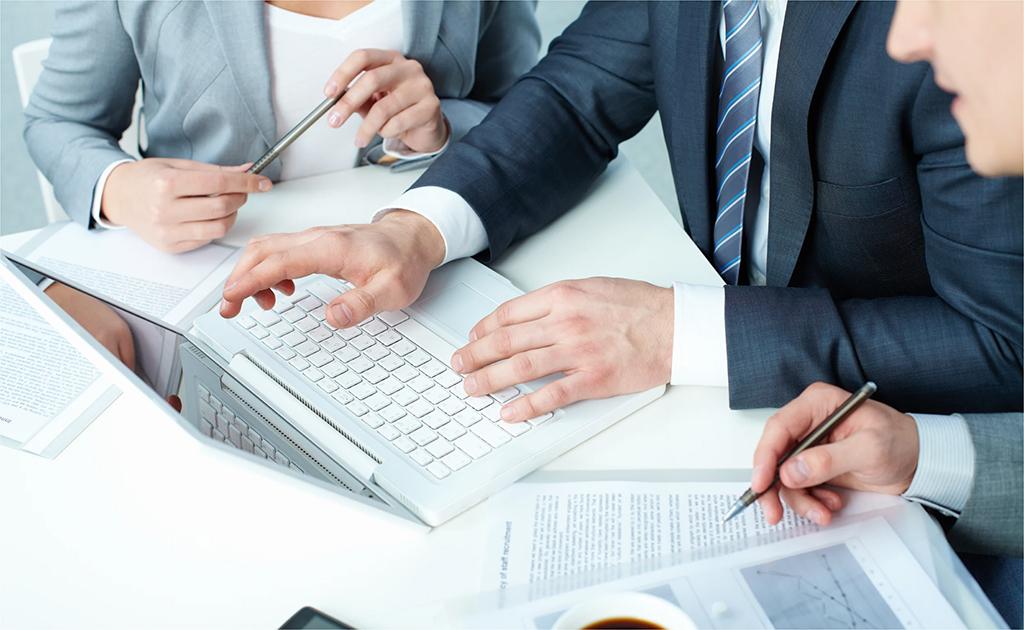 Employees drafting business plan | Botkeeper