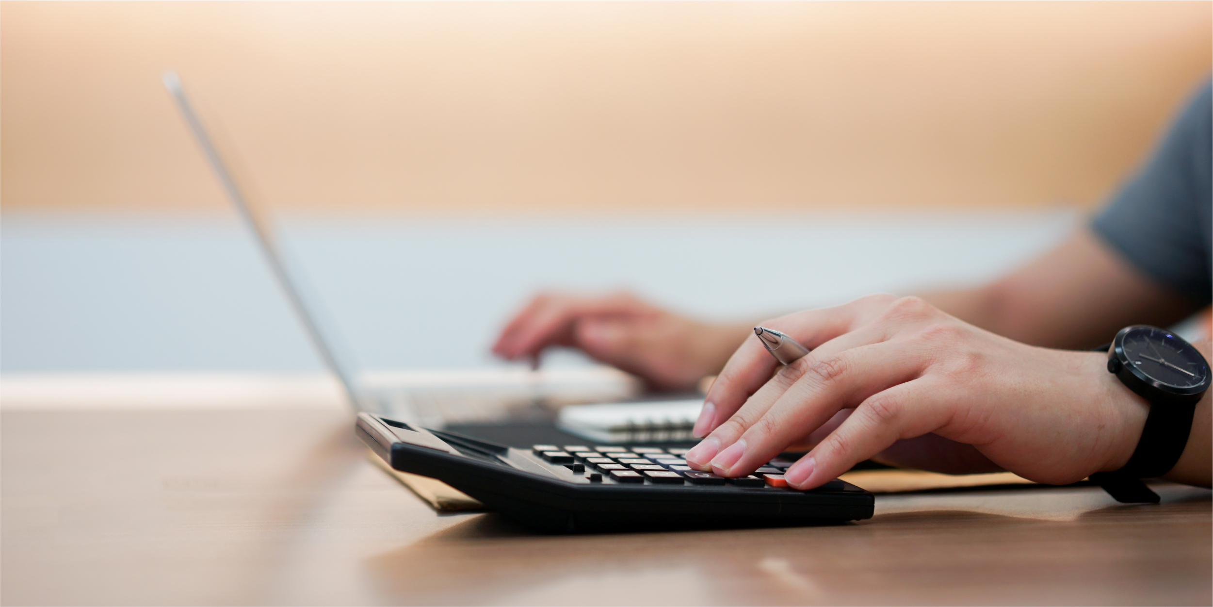 accountant-employee-man-hand-pressing-calculator-typing-keyboard-laptop_Blog copy