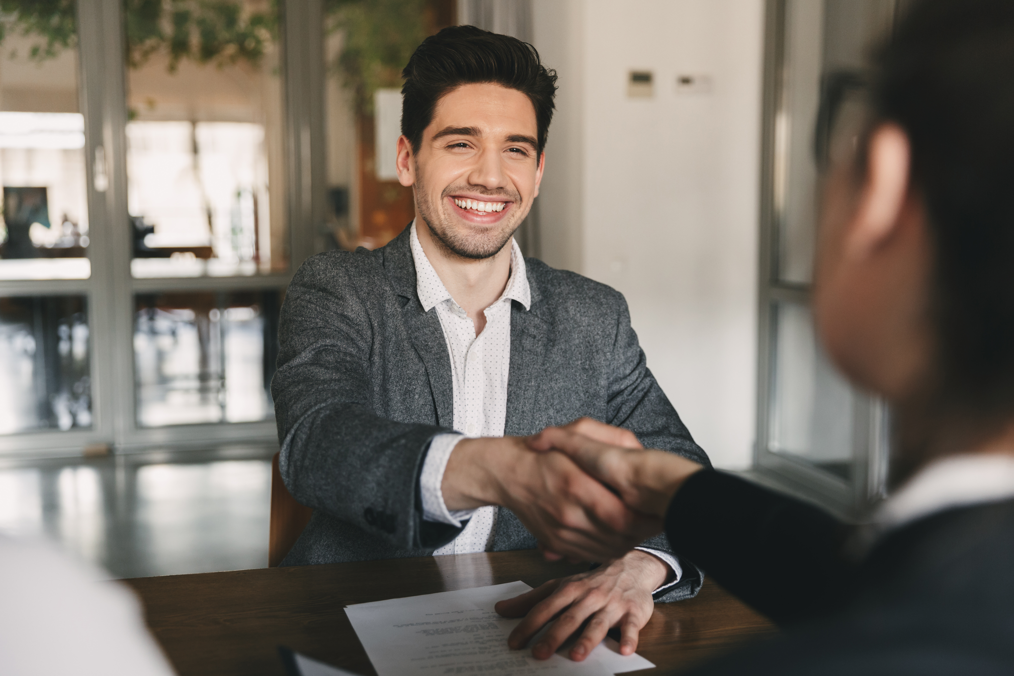 business-career-placement-concept-happy-caucasian-man-30s-rejoicing-shaking-hands-with-employee-when-was-recruited-during-interview-office   Botkeeper