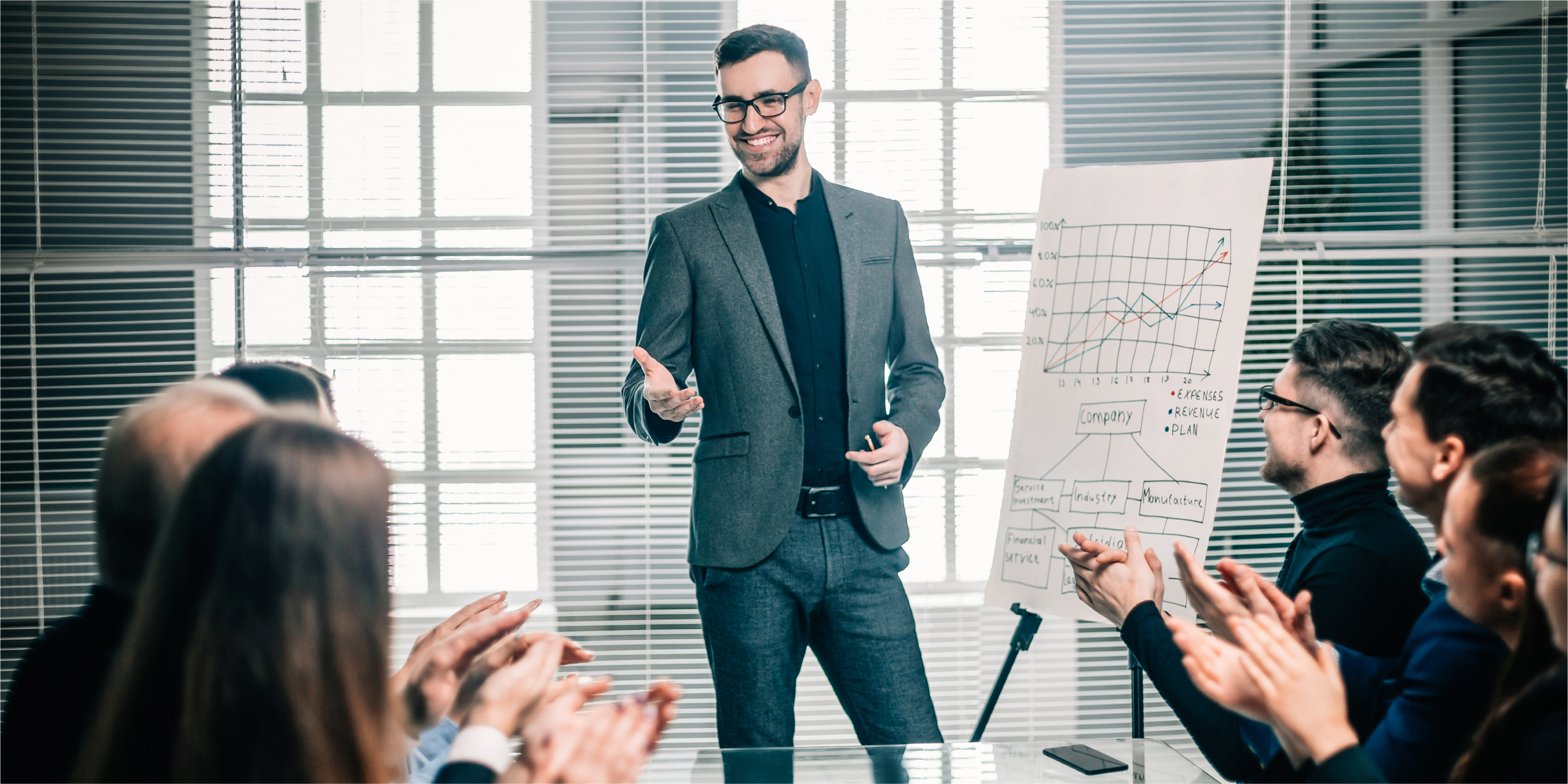 business-team-applauds-speaker-business-presentation-meetings-partnerships_Blog_Botkeeper