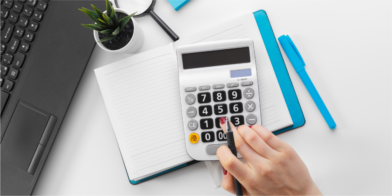 business-woman-working-with-financial-data-hand-using-calculator_Botkeeper