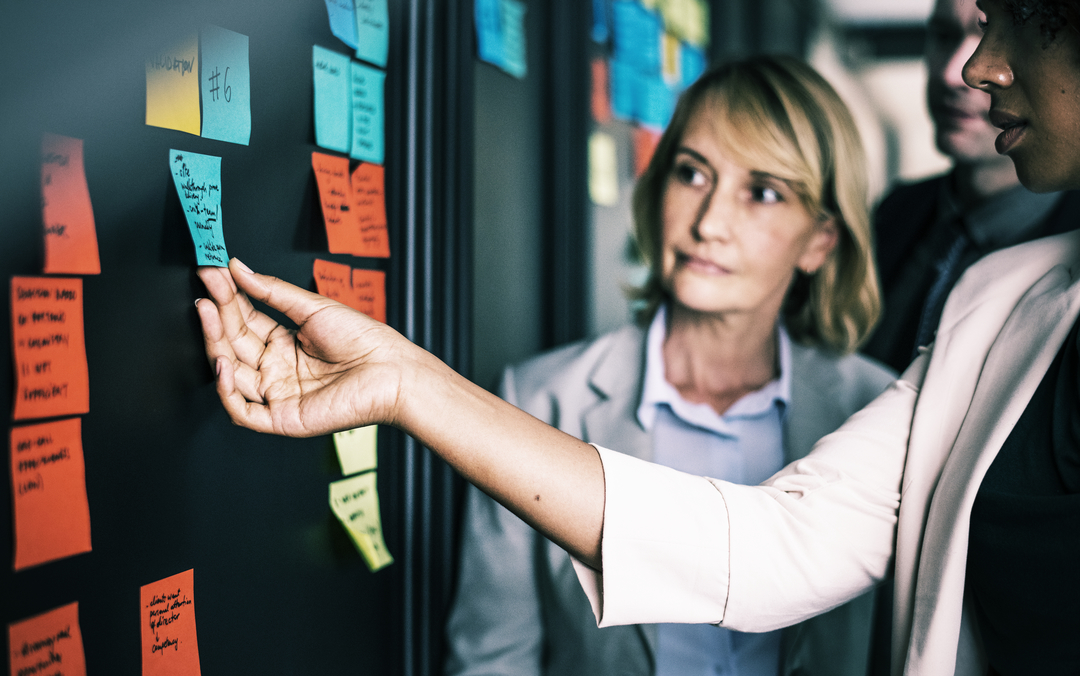 businesspeople-planning-tasks-with-sticky-notes_Botkeeper