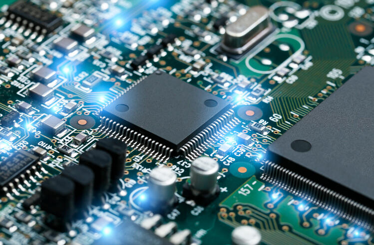 closeup-electronic-circuit-board-with-cpu-microchip-electronic-components-background | Botkeeper