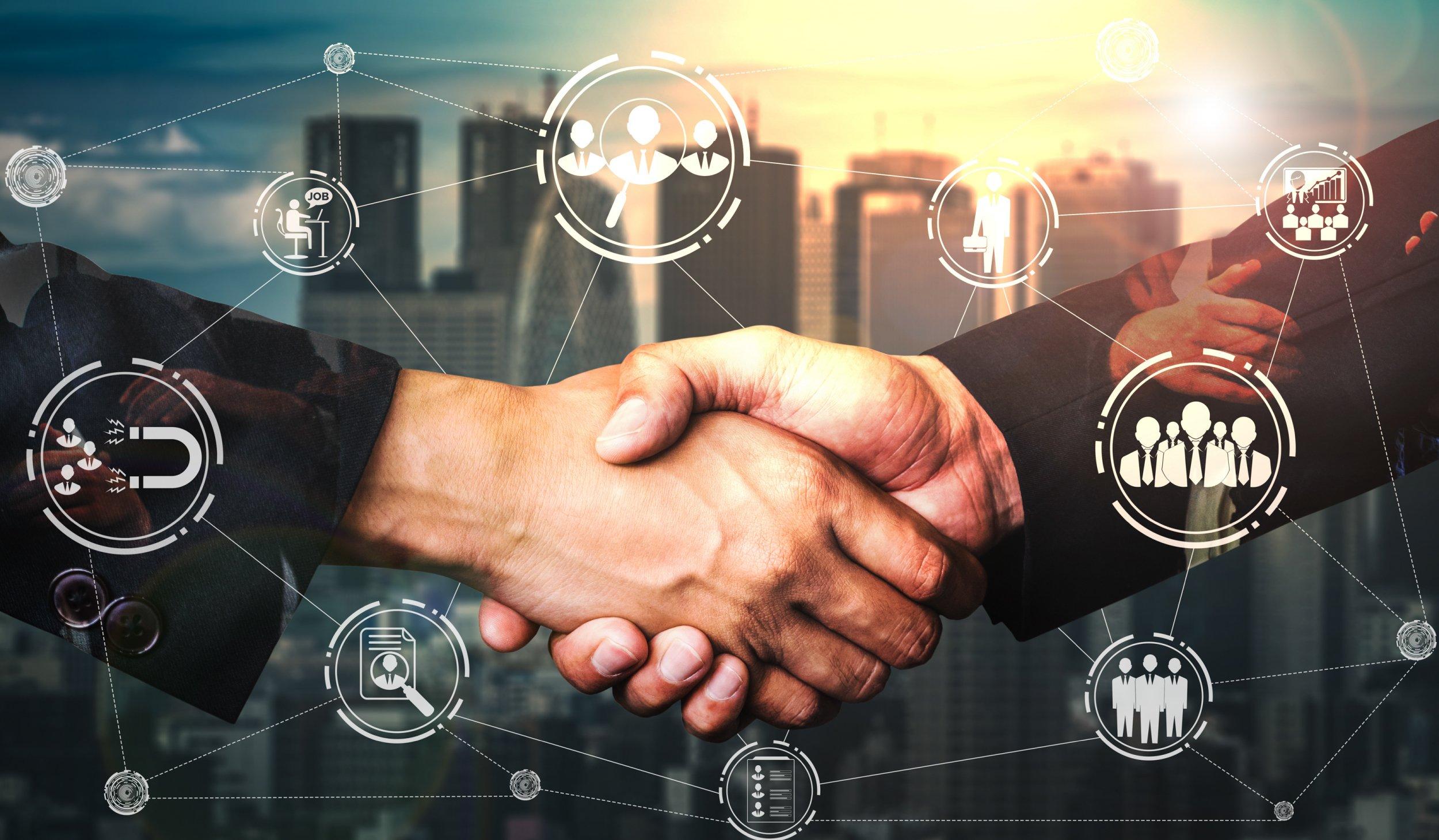 Businessmen handshake | Botkeeper