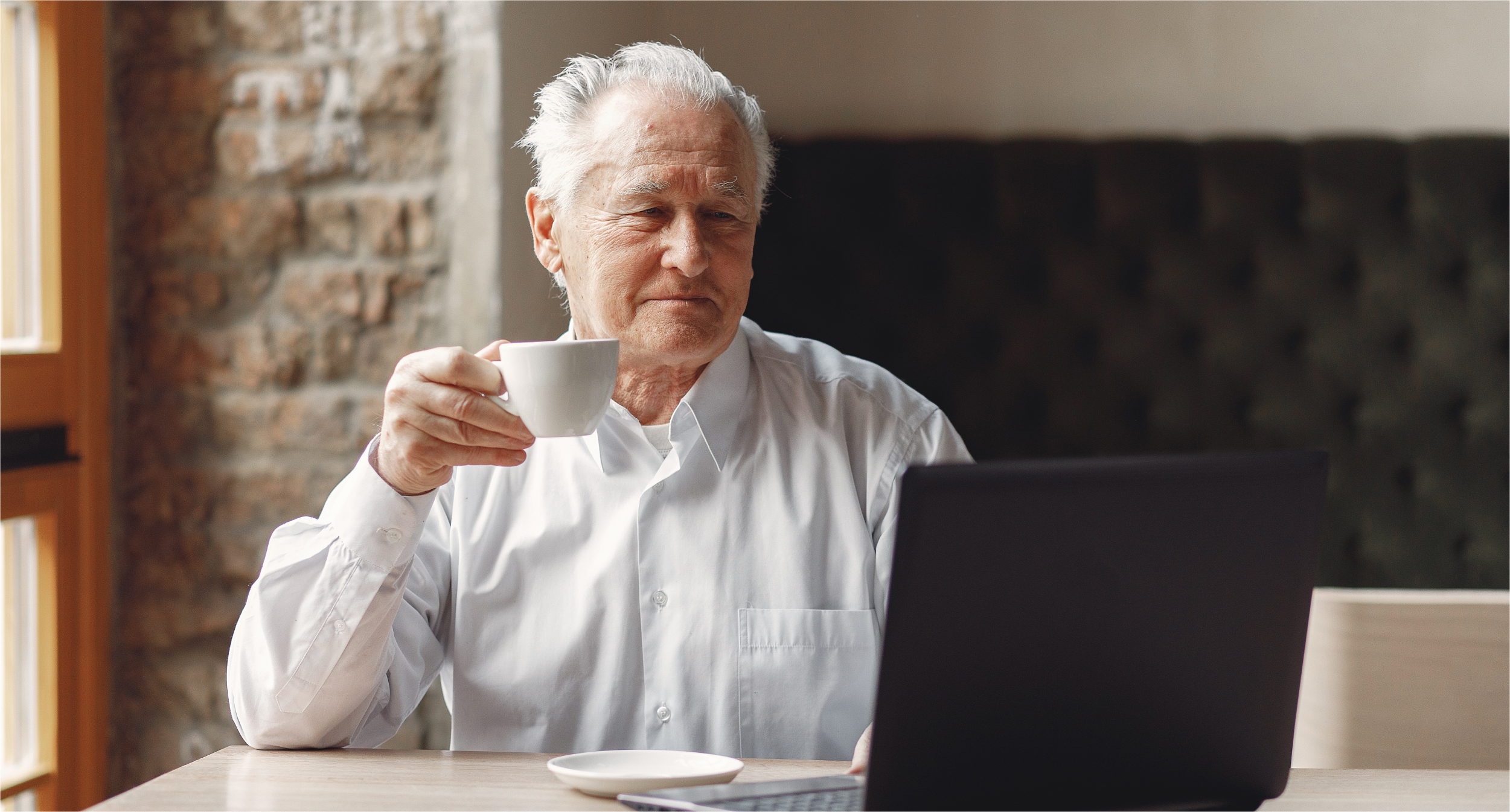 old-man-sitting-table-working-with-laptop   Botkeeper
