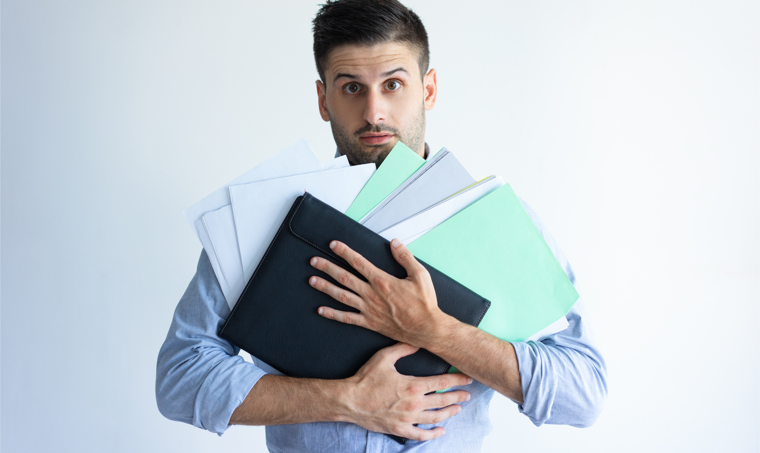 puzzled-office-worker-holding-pile-documents-32