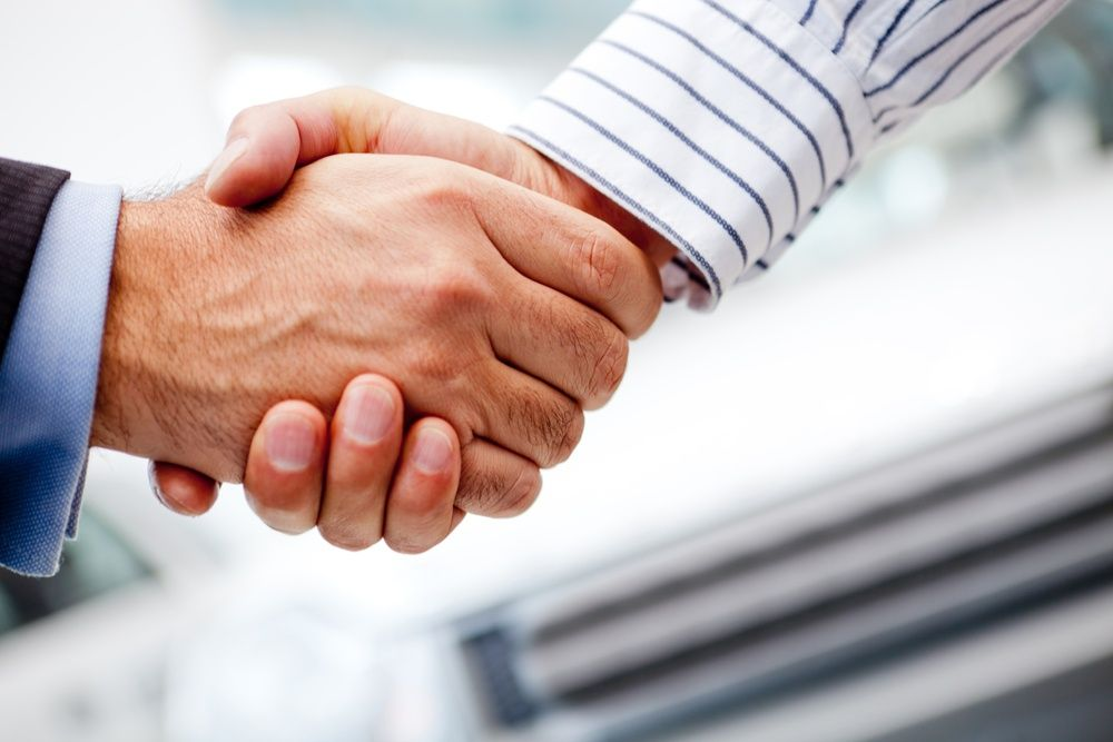 Business handshake_The Most Important Metric for Firm Growth Is Revenue Per Client—Here's Why_Botkeeper