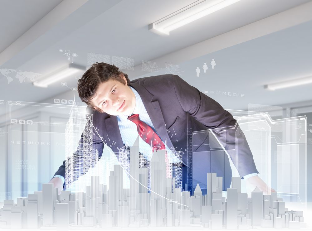 Businessman looking at digital construction project of modern city