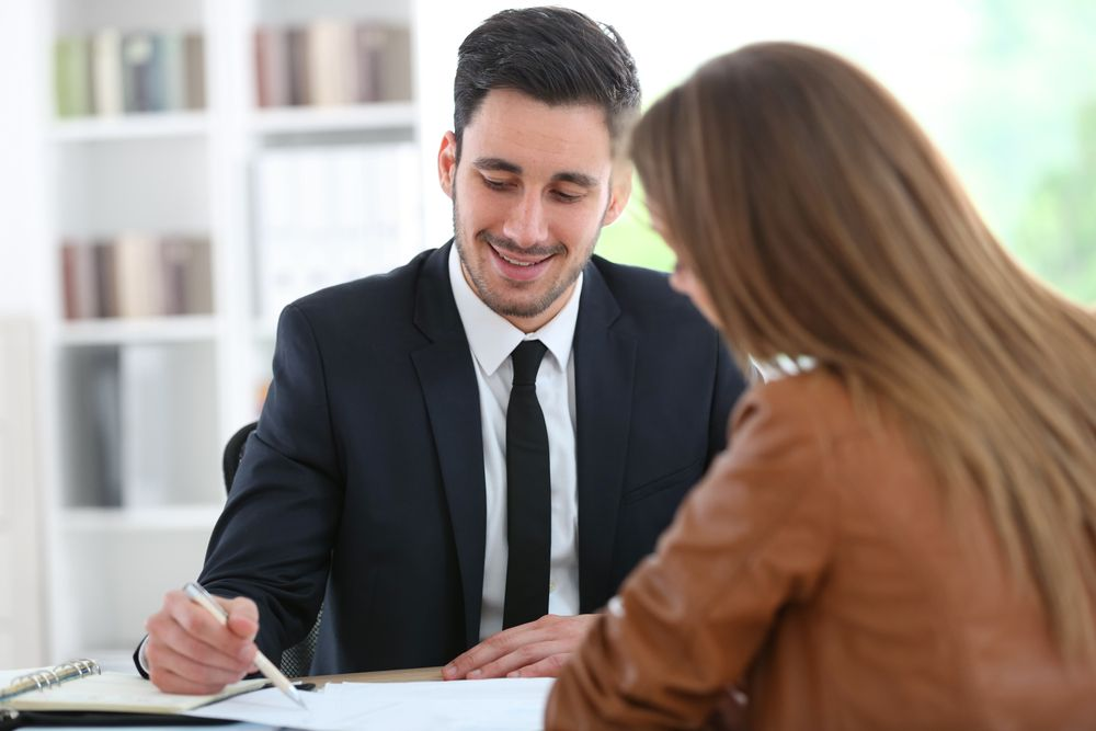 Woman meeting financial adviser in office_Building CAS in 2021: What Your Firm Needs to Know to Get Started_Botkeeper